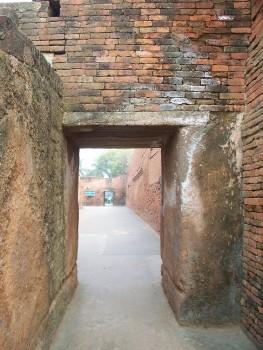 a red brick doorway in the ruins of Nalanda University