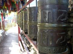 large bronze prayer wheels at Tso Pema